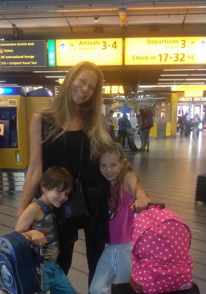 alleenstaande-ouder-met-kinderen-op-vakantie